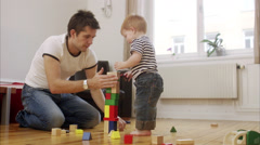 Father and son building a tower, Sweden. Stock Footage