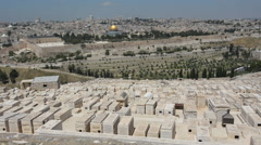 Mount of Olives Jewish Cemetery with Jerusalem old city skyline Stock Footage