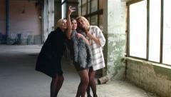 Three young beautiful girl in expensive fur to make self abandoned warehouse Stock Footage