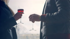 Strict man with a woman ticking glass of red wine on a background window - stock footage