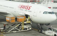 Cargo handling Containers being stowed in the hold of a Airbus A330 aircraft Stock Photos