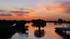 Time-lapse sunset over swollen Trinity River forest Stock Footage