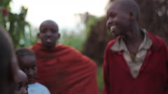 Happy African village children jump, Samburu, Kenya, Africa Stock Footage