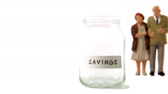 A jar being filled with coins. Stock Footage