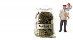 A jar with coins that decreases. Stock Footage