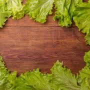 Cos lettuce isolated on wood board Stock Photos