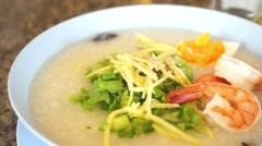 Rice porridge with shrimp, Thai breakfast Stock Footage