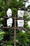 Group of outdoor halogen spotlight mounted on tower Stock Photos
