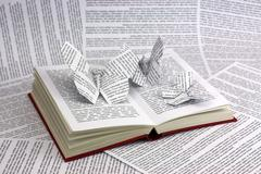 Origami butterflies coming out of a book Stock Photos