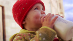 A girl with a feeding bottle, Sweden. Stock Footage