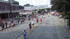 Runners on Main Street USA heading to finish line Stock Footage