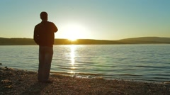 Silhouette Man On A Morning Walk Stock Footage