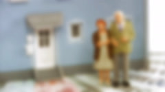 Senior couple standing on bills in front of a house. Stock Footage