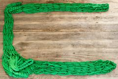 Green Rope and Textured Wood, Coil of white rope set against highly textured Stock Photos