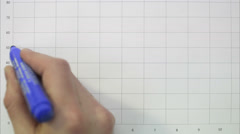 A hand writing a diagram on a whiteboard. Stock Footage