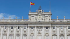 Spanish flag over the building of the royal palace in Madrid Stock Footage