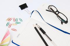 Open notebook, glasses and stationery Stock Photos