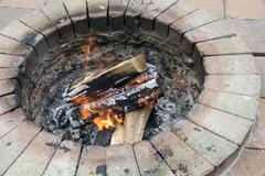 Burning wood in a garden fire pit Stock Photos