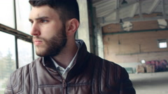 Cool seductive man in brown leather jacket Stock Footage