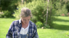 A woman doing carpentry in a garden, Sweden. Stock Footage