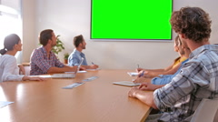 Creative team looking at green screen - stock footage