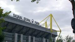 Name of Dortmund football (soccer) stadium framed by tree Stock Footage