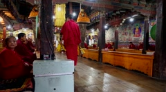 Young Buddhist Monk Bowing at Morning Prayer Stock Footage