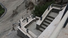Stock Video Footage of Panning View of Valley Framed with Stairs of a Buddhist Monastery