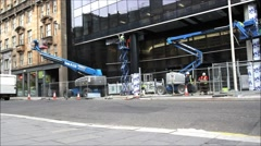 14 June, 2015, Builders working in the streets of Glasgow, Scotland, HD footage Stock Footage