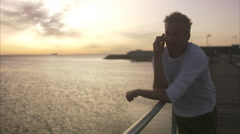 A man with a cell phone by the sea, Malmo, Sweden. Stock Footage