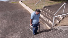 DISABLED-PARAPLEGIC man with walker and stairs 3 Stock Footage
