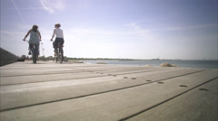 Two cyclists passing by, Malmo, Skane, Sweden. Stock Footage
