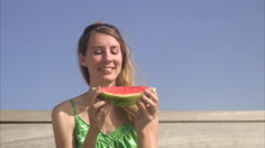 A woman having a water melon, Sweden. Stock Footage