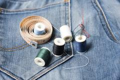 Jean pants and sewing Stock Photos