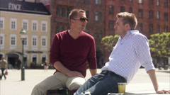 Two men talking, Malmo, Skane, Sweden. Stock Footage