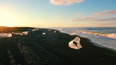Global Warming Climate Change Concept. Icebergs on Black Sand Beach. Stock Footage