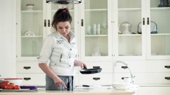 Young woman setting induction hob in kitchen at home HD Stock Footage