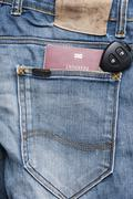 Passport in jean pocket with car key Stock Photos