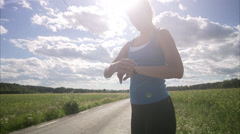 A woman jogging next to a corn field, Sweden. - stock footage