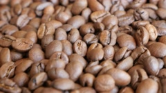 Arabica type coffee beans on table slow dolly shoot moving 4K 3840X2160 Ultra Stock Footage