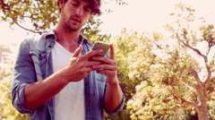 Furious hipster man having phone call in the park Stock Footage