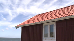 A red cottage a sunny day, Bohuslan, Sweden. Stock Footage