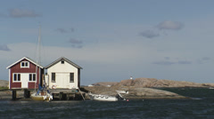 Two fishing-huts at twilight, Bohuslan, Sweden. Stock Footage