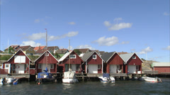 Sailing-boats and fishing-huts, Smogen, Bohuslan, Sweden. Stock Footage