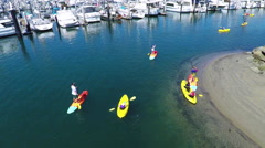 Aerial of Kayak and Paddle board class - stock footage