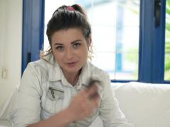 Young woman complaining about her smartphone sitting on sofa at home NTSC - stock footage