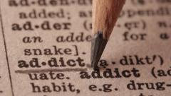 Addict - Fake dictionary definition of the word with pencil underline Stock Footage