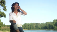 A woman using a mobile phone, Sweden. Stock Footage