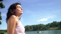 A woman enjoying the sun, Sweden. Stock Footage