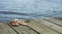 Stock Video Footage of Sandals on a jetty, Sweden.